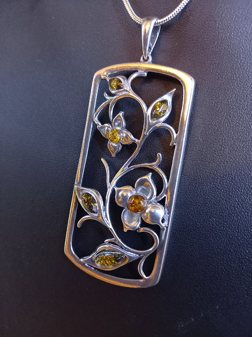Art Nouveau style Amber and silver pendant