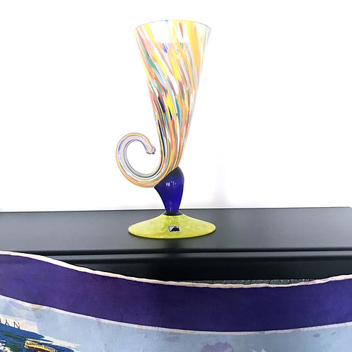 Goblet made of colored glass with funny shape.