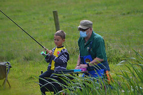 A young angler and his coach
