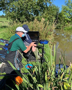 Lead Junior Coach instructing a Junior angler during a Taster session.