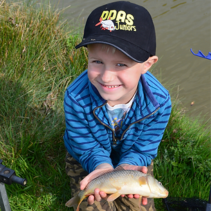 A young angler, Jake, holding a little Carp. His first ever fish.