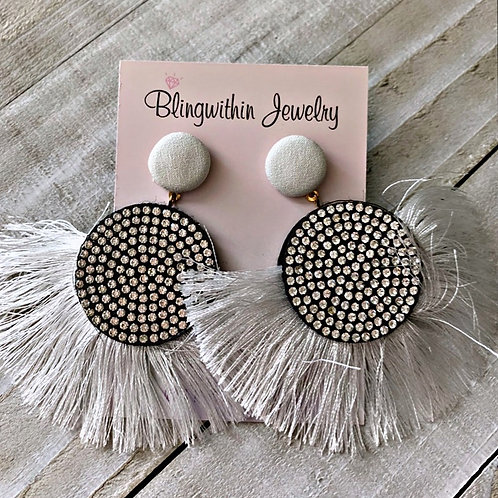 Sparkles and tassels in white