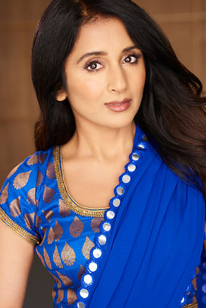 Demi Mann wearing a bluse saree. This is Demi Mann's acting headshot in Indian Dress Saree