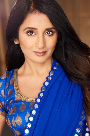 Demi Mann wearing Blue Saree Headshot Photo taken in Los Angeles, Demi can speak Hindi & Punjabi Fluently