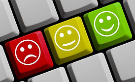 Smiley and frowning faces on computer keyboard