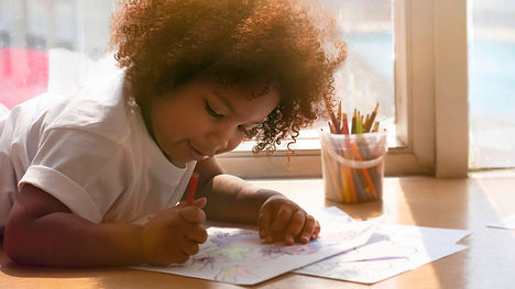 Little African girl painting and drawing