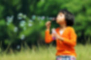 Children playing with soap bubbles on a
