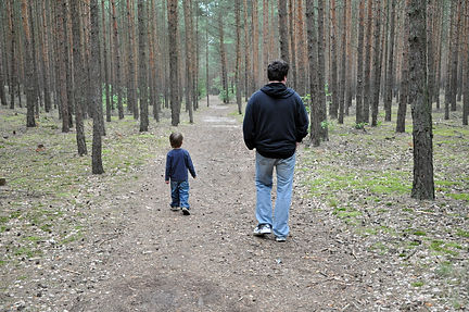 Son and father in the forest.jpg