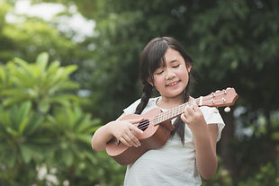 Beautiful asian girl playing ukulele, Ou