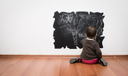 Toddler drawing on the wall.jpg