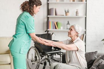 Caregiver Helping Patient Stand Up