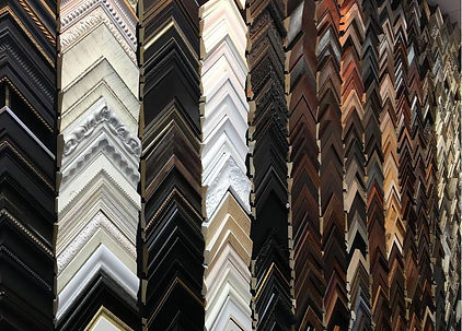 Wall of moulding samples for custom framing