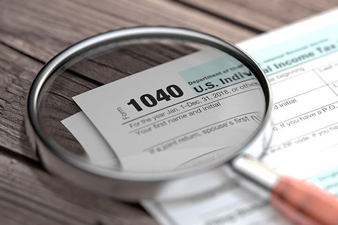 magnifying-glass-1040-tax-md.jpg