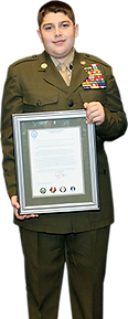 young marine holding certificate