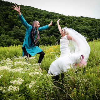 Jumping bride & groom