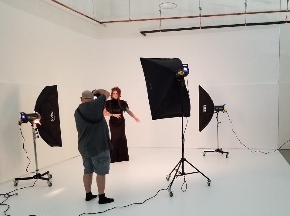 Behind the scenes of a professional portrait shoot.