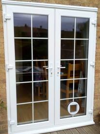 french doors with geo bars.jpg