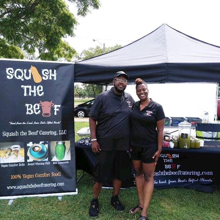 Squash the Beef owners Candace and Kurtis pose in front of their festival tent
