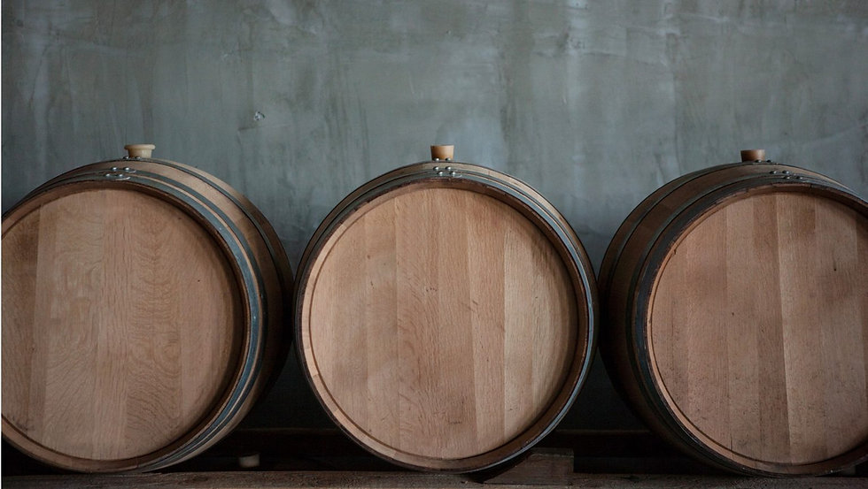 Wine barrels stacked in a warehouse for a giveaway