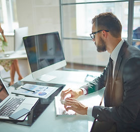 Young employee looking at computer monit