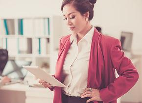 Beautiful female entrepreneur reading in