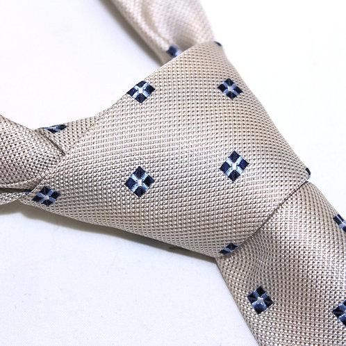 Sao Tome | Designer Woven Men's Necktie by SUH SOO MI | Cream Foulard Tie with Navy & White Cross Pattern