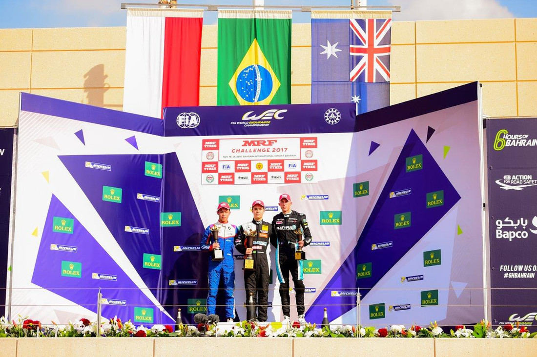 Dylan (right) with Felipe Drugovich (centre) and Presley Martono (left) on the podium at the FIA WEC event in Bahrain Nov 2017