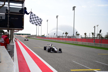 Young crossing the line to win in Bahrain Dec 2019