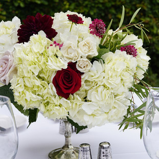 white blush and burgundy floral table centerpiece