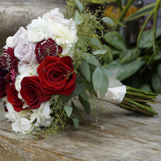 Burgundy roses and white bridal bouquet