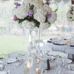 White hydrangeas, lavender stock and lavender roses with baby eucaliptus