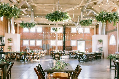 Greenery Chandeliers and hanging Pieces as an extravagant addition to your wedding reception