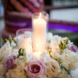 Candles and lavender roses with hydrangeas wfloral wreath wedding reception flowers