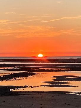 orange sunset over beach.jpeg