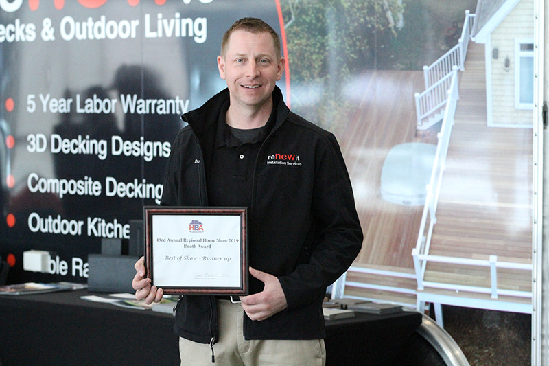 Dustin Hart of Renew It Decks and Outdoor Living winning best booth at 2019 Home Show
