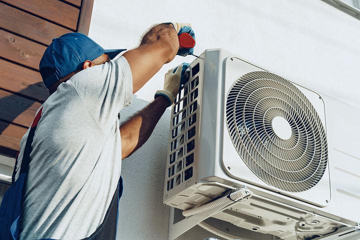 repairman-uniform-installing-outside-unit-air-conditioner.jpg