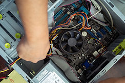 top-view-of-hand-fixing-computer-cpu-mai