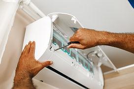 close-up-photo-repairman-fixing-air-conditioner-room.jpg