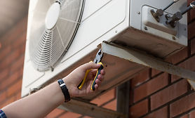 closeup-photo-male-technician-installing-outdoor-air-conditioning-unit.jpg