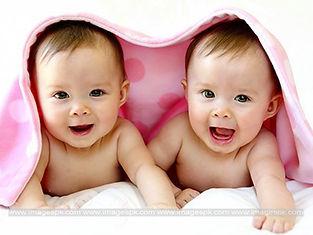 Twin-Babies-Under-Towel.jpeg