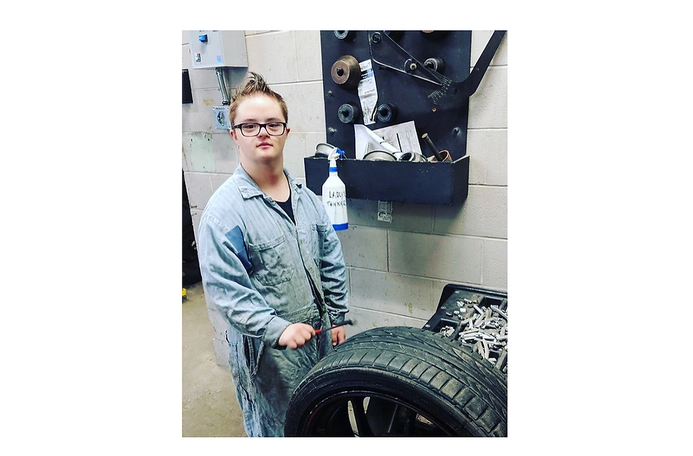 boy with down syndrome in coveralls