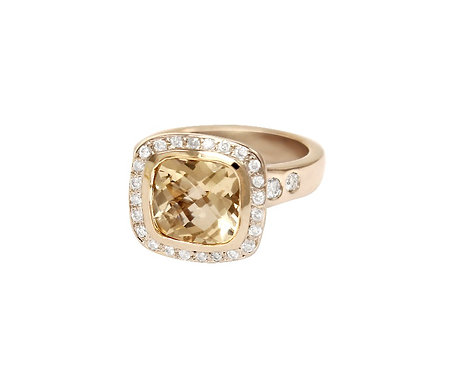 Yellow morganite ring set in yellow gold with pave and flanking diamonds