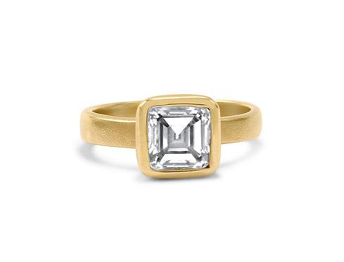 Classic Asscher cut diamond set in matte 14k gold
