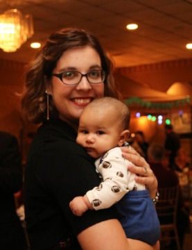 Sarah M. Bowen with a baby at the Alpha Omega Center Fall Banquet