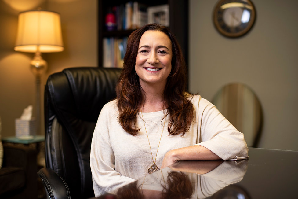 Dr. Kathleen McHugh sitting in her office.