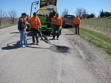 Spray injection road repair