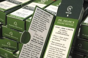 "Boxes of ""Healer"" CBD/THC cannabis drops await distribution at the Kind Therapeutics."