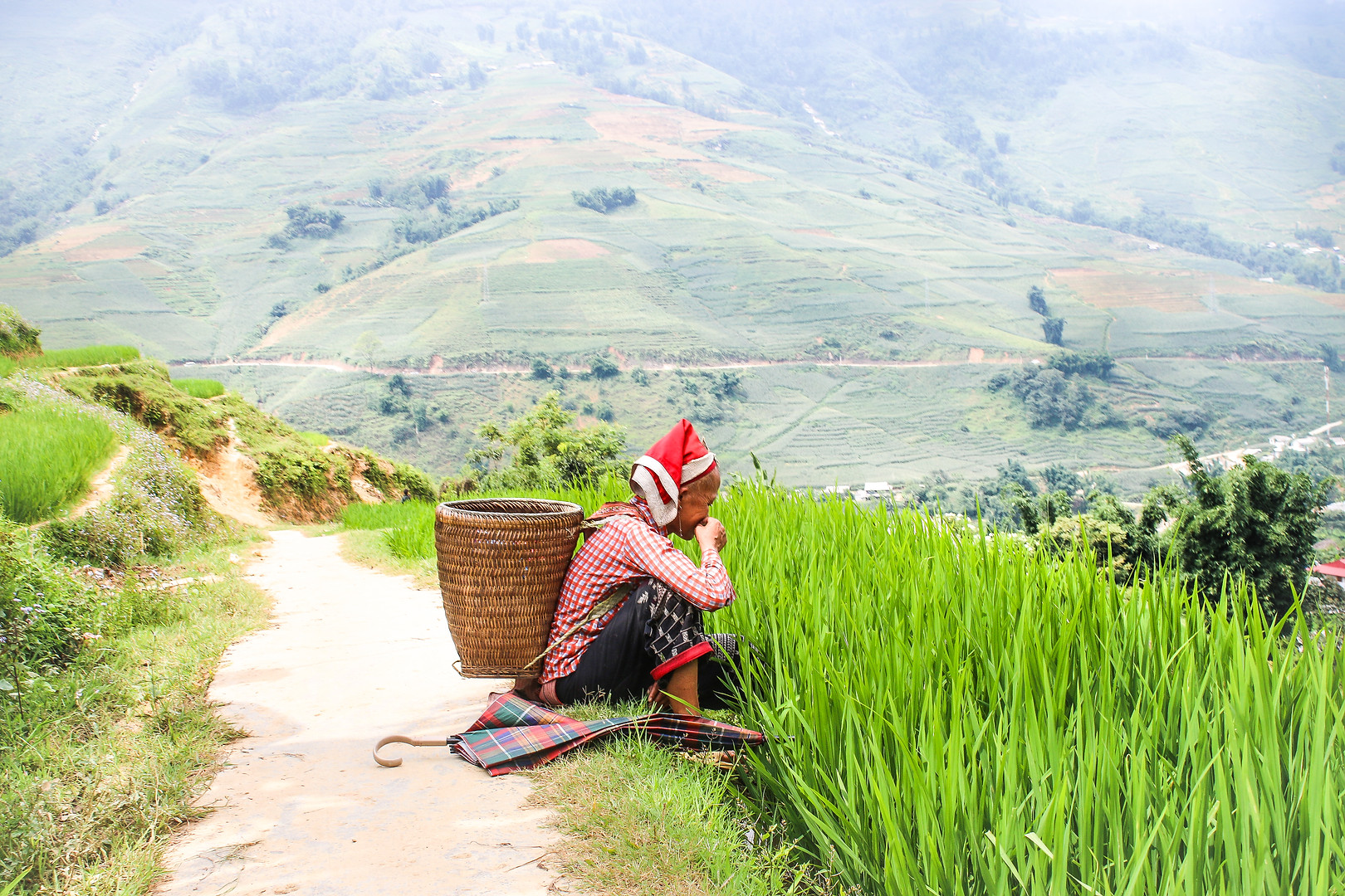 Red Dhao Woman Resting on the Trail