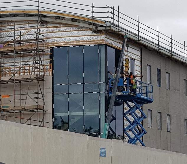Glazers putting in the glass wall.