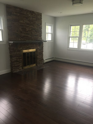 Staged Long Island | Staging Your Home For Sale | Home Stager | Configuring Your Home | Increase Value | Sell Your Home | Family Room | Before